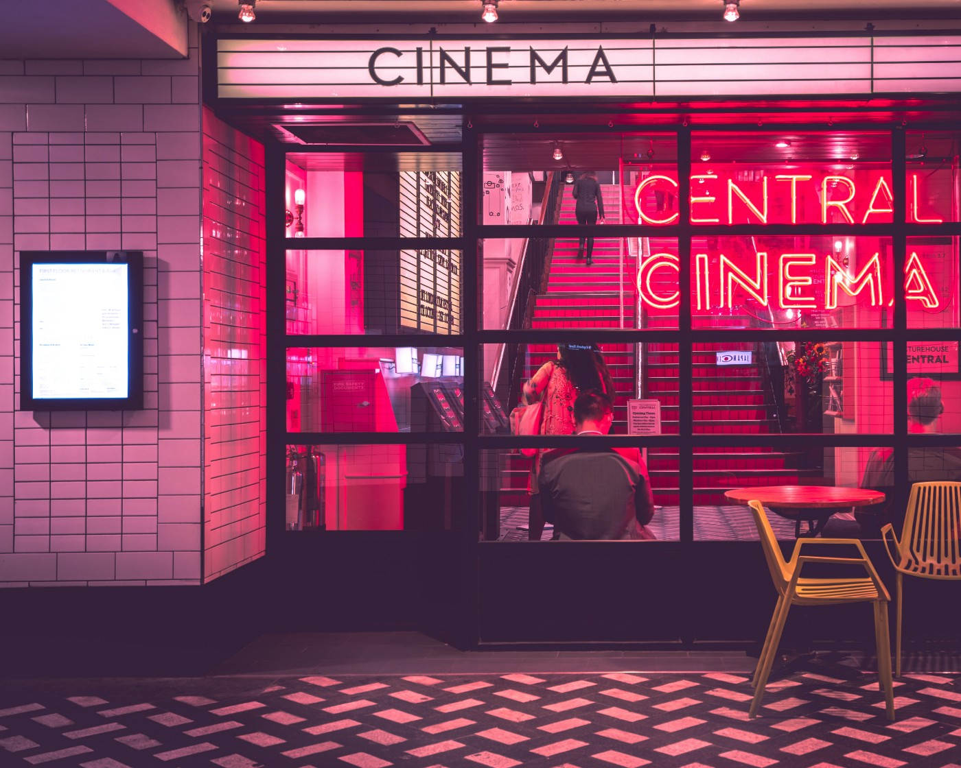 Image of a cinema in a pink hue