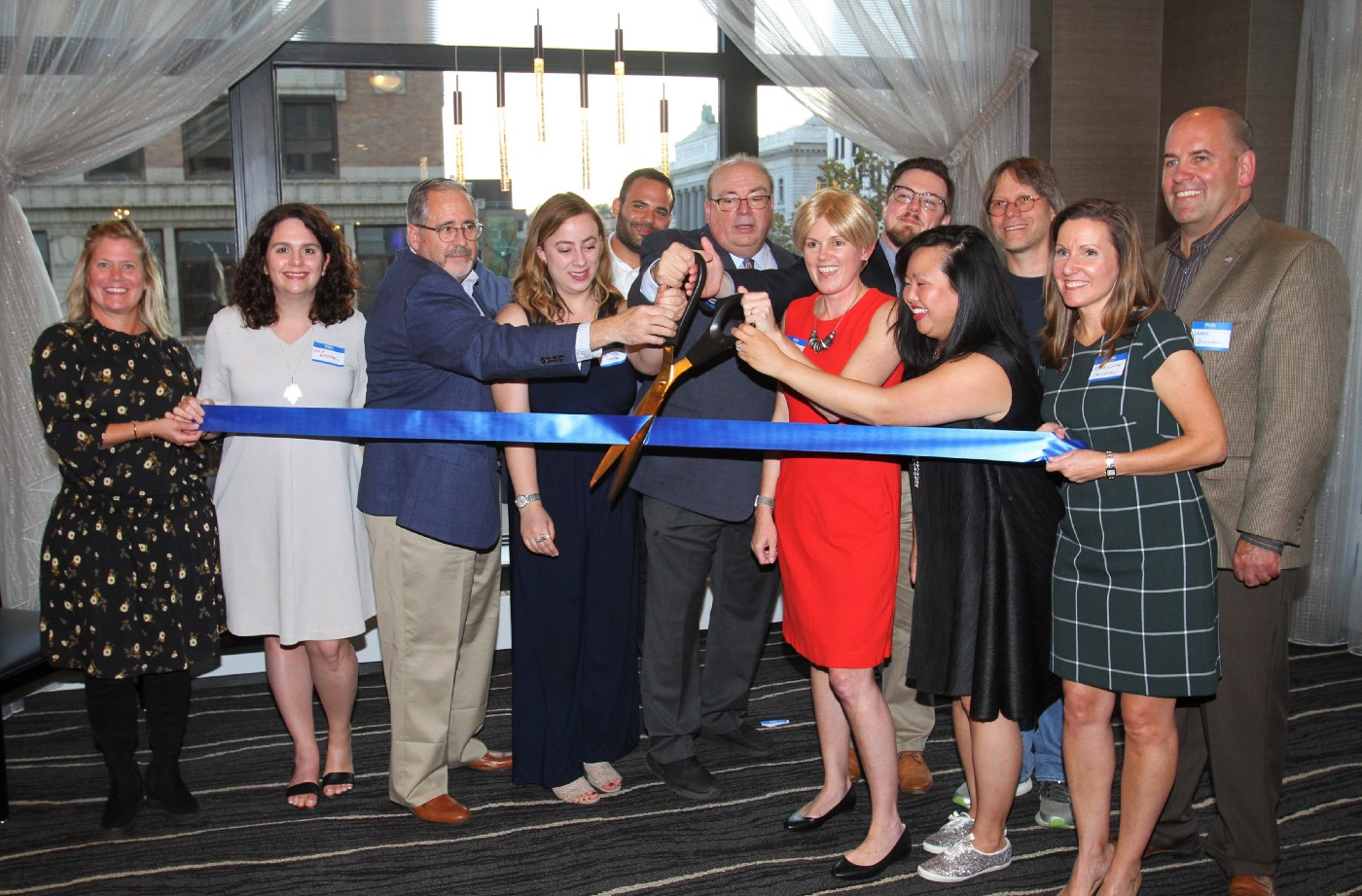 The Mahoning Matters team cuts a symbolic ribbon at the website's launch party on Oct. 10, 2019.