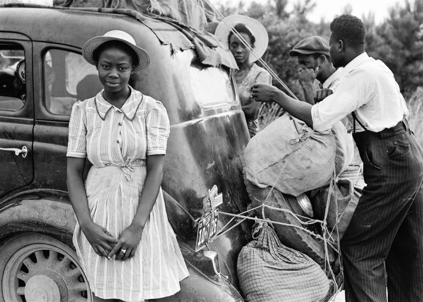 African American family preparing for long-distance driving trip prior to 1950.