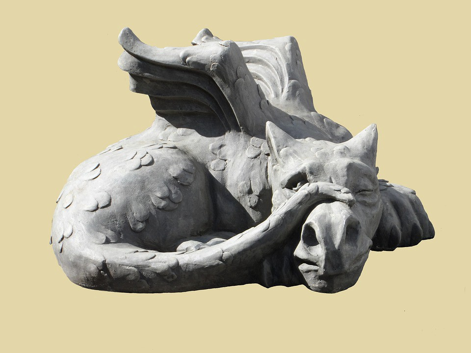 a stone sculpture of a dragon depicting jealousy
