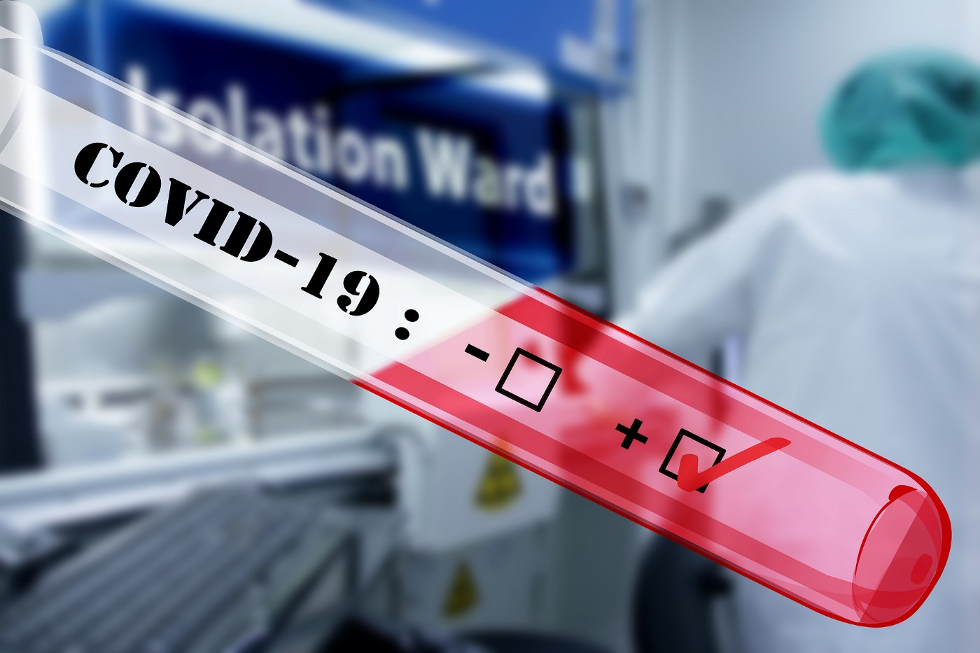Picture of a test tube with a blood sample in it and the words COVID-19 written on the tube. The box next to the plus sign is checked, while the box next to the minus sign is blank. In the background, a healthcare provider can be seen next to the Isolation Ward sign.
