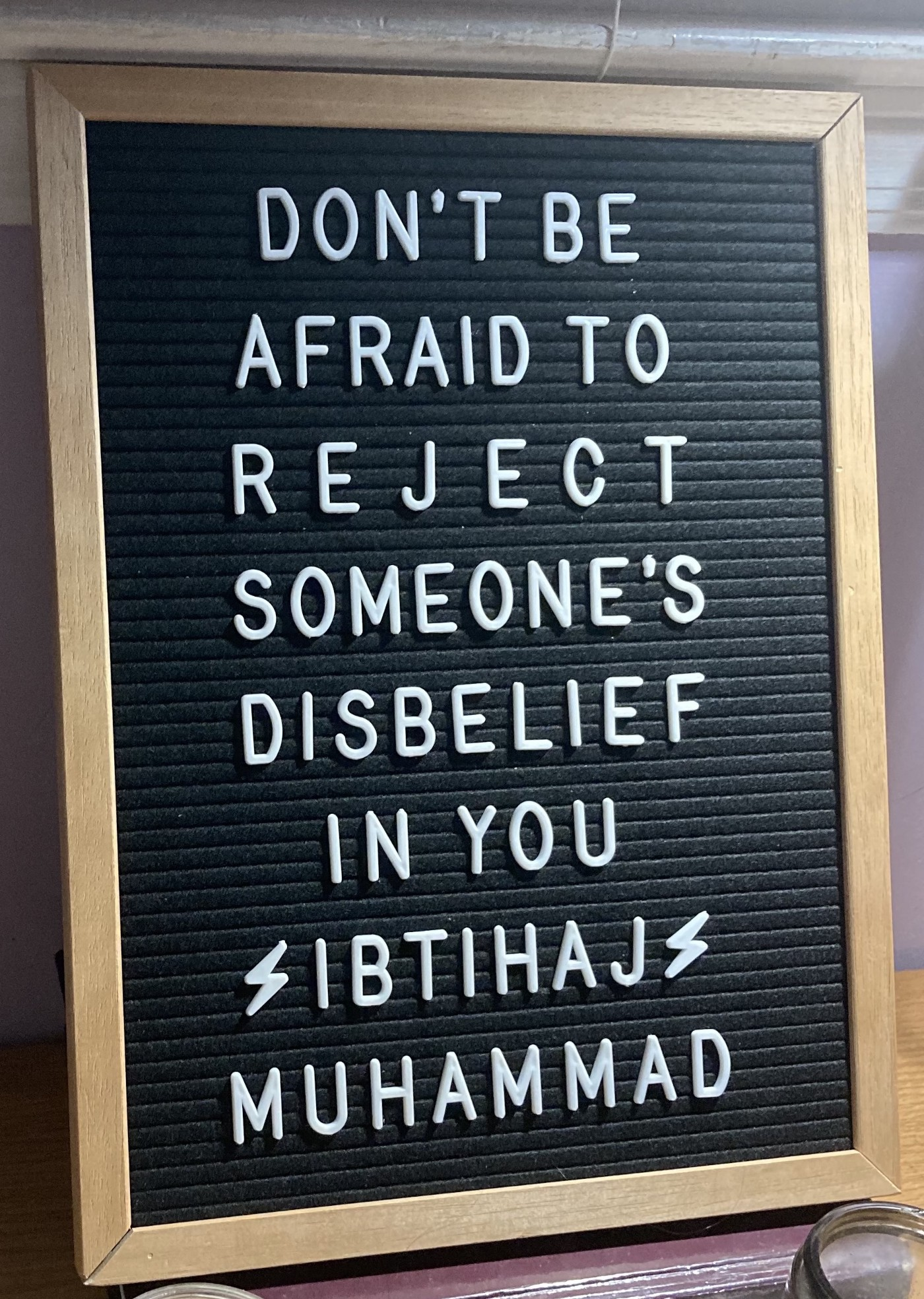 """Message board stating """"Don't be afraid to reject someone's disbelief in you. Ibtihaj Muhammad."""