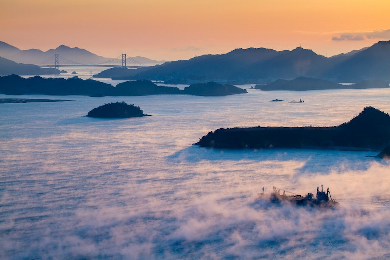 Fog covers the Seto Inland Sea as seen from a viewpoint in Setouchi