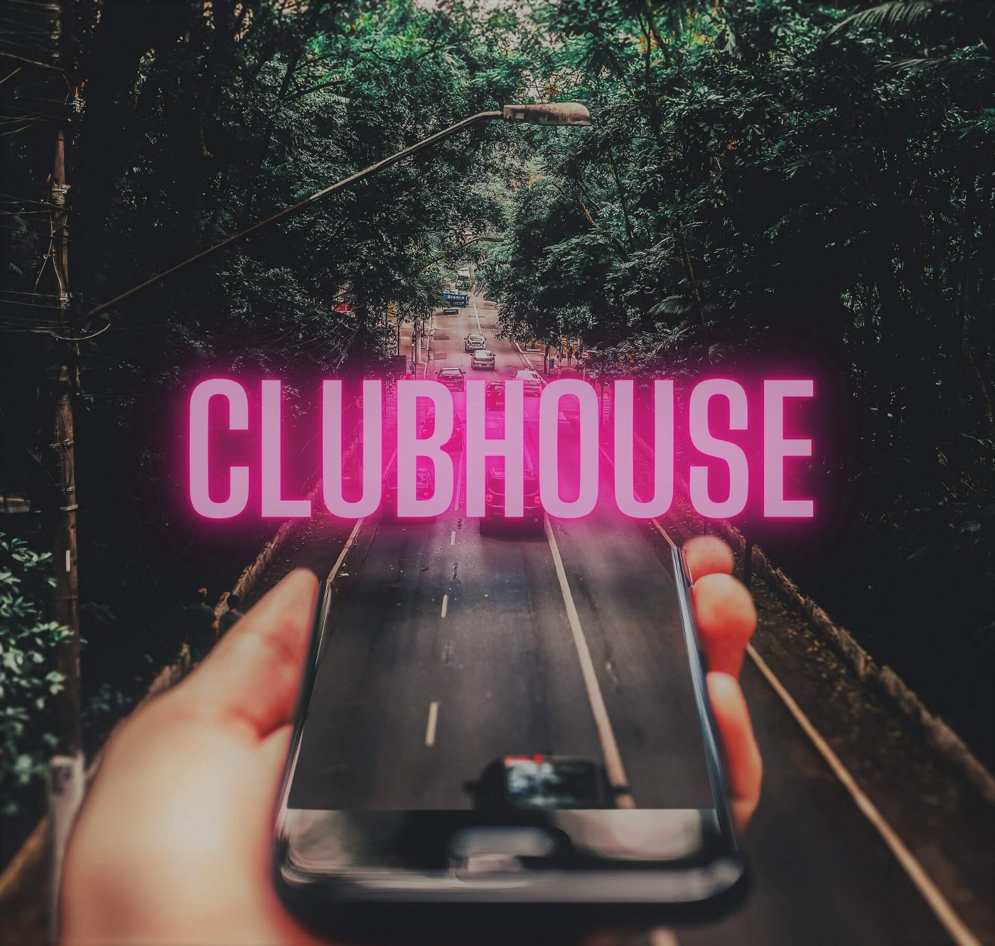 Pink lettering mentioning clubhouse on a background showing a smartphone that transforms into an open road to depict the marketing potential of social media.