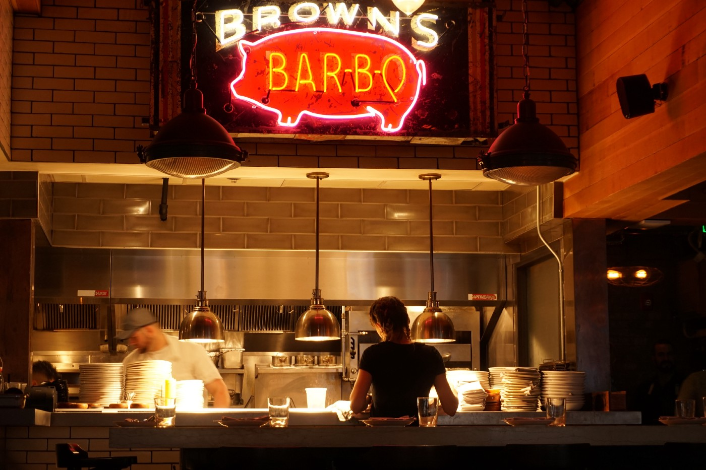 brown's bbq sign with someone getting food
