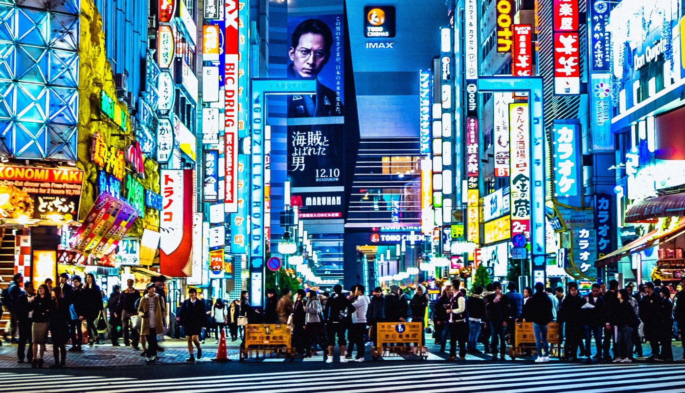 A busy Tokyo street at night.