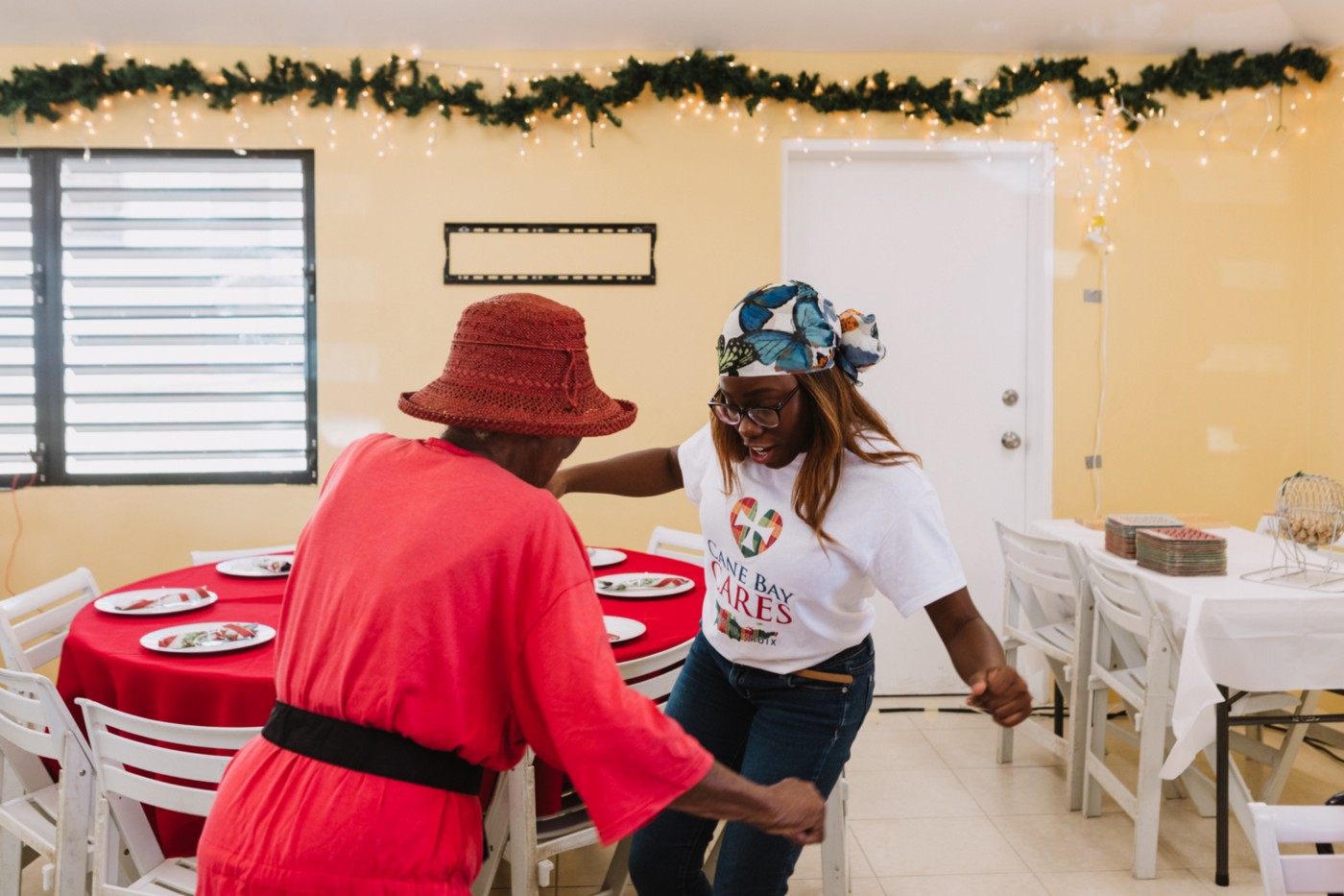 Cane Bay Cares, the charitable giving arm of Cane Bay Partners, hosts a holiday luncheon for the elderly.
