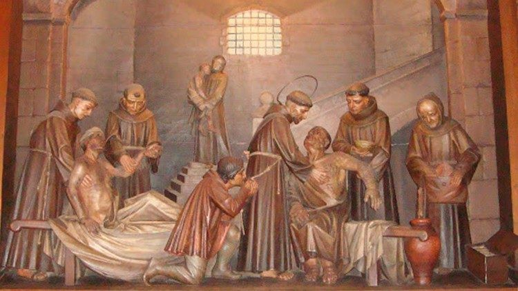 Painting of St. Francis ministering to lepers with his confreres.