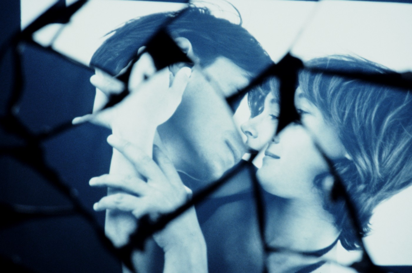 Shattered glass image of a man and woman about to kiss.