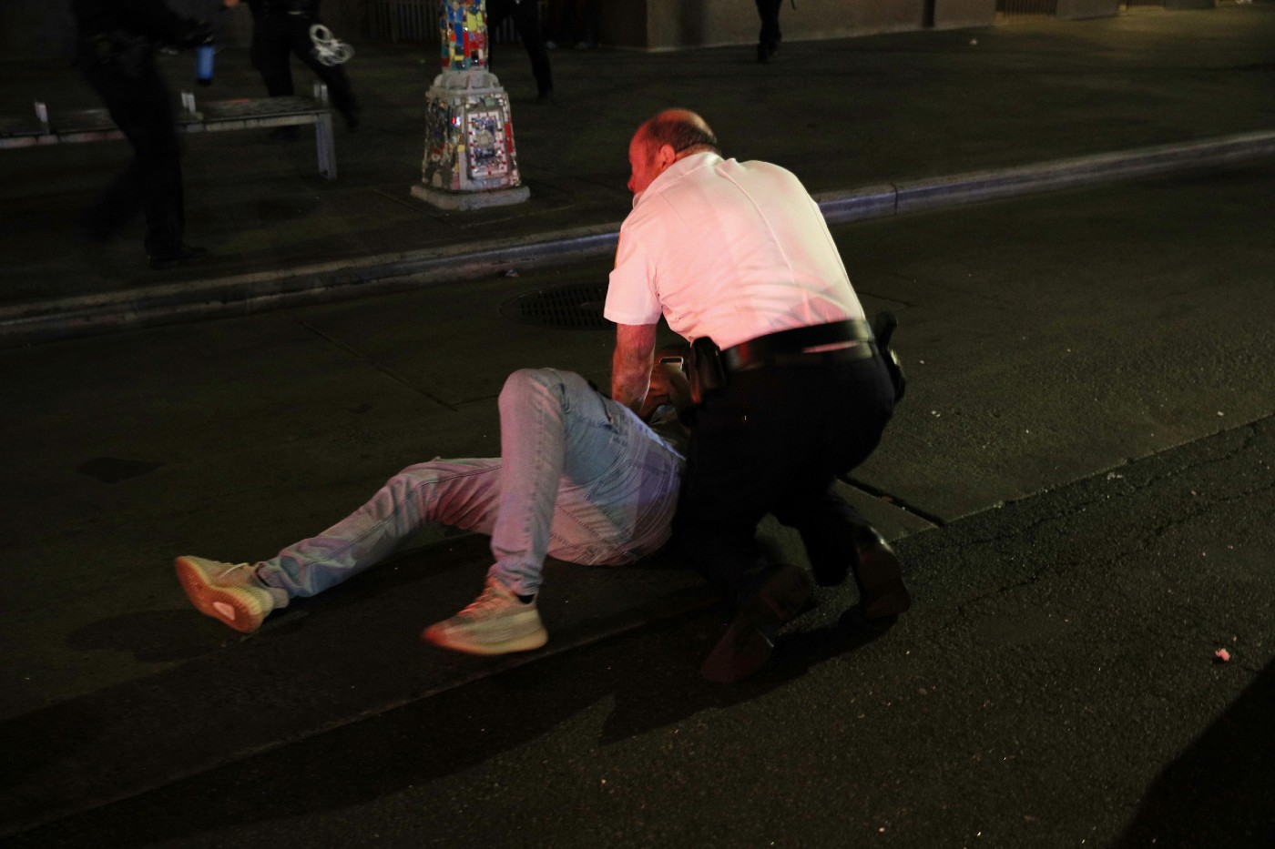Police with man on the ground