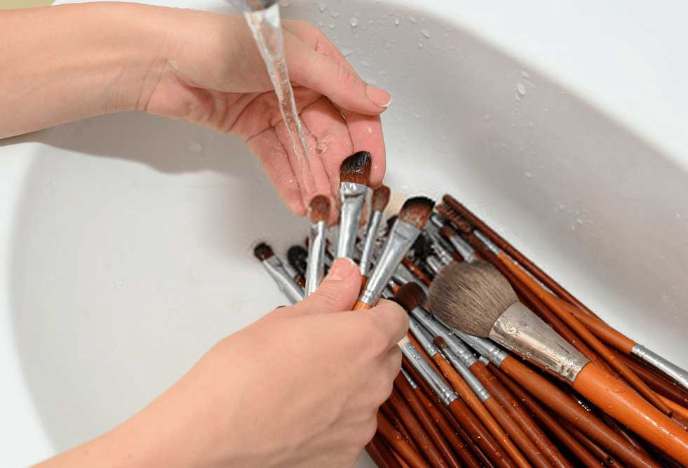 How often should makeup brushes be cleaned