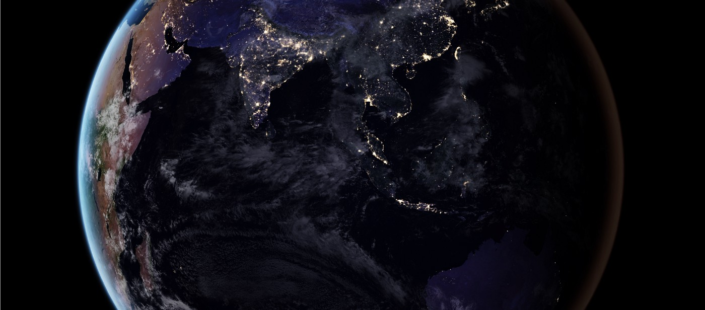 Image of the Earth at night, taken from Space, showing the outlines of Asia.
