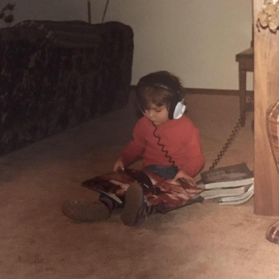 Young child listening to music through headphones