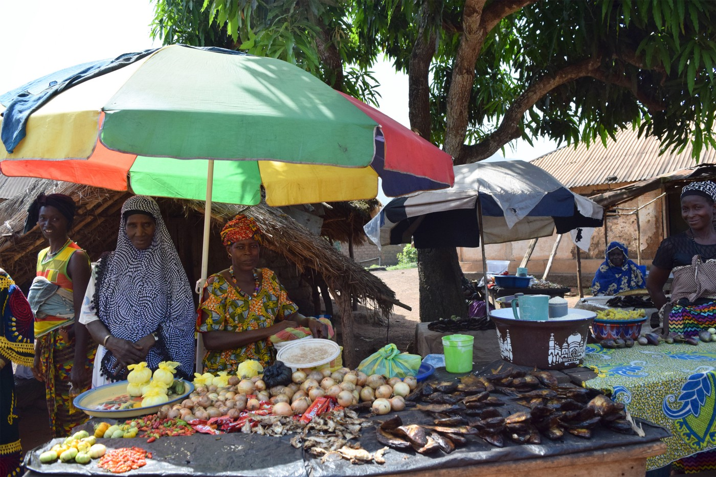 Guinean women at their food stall in a local market.