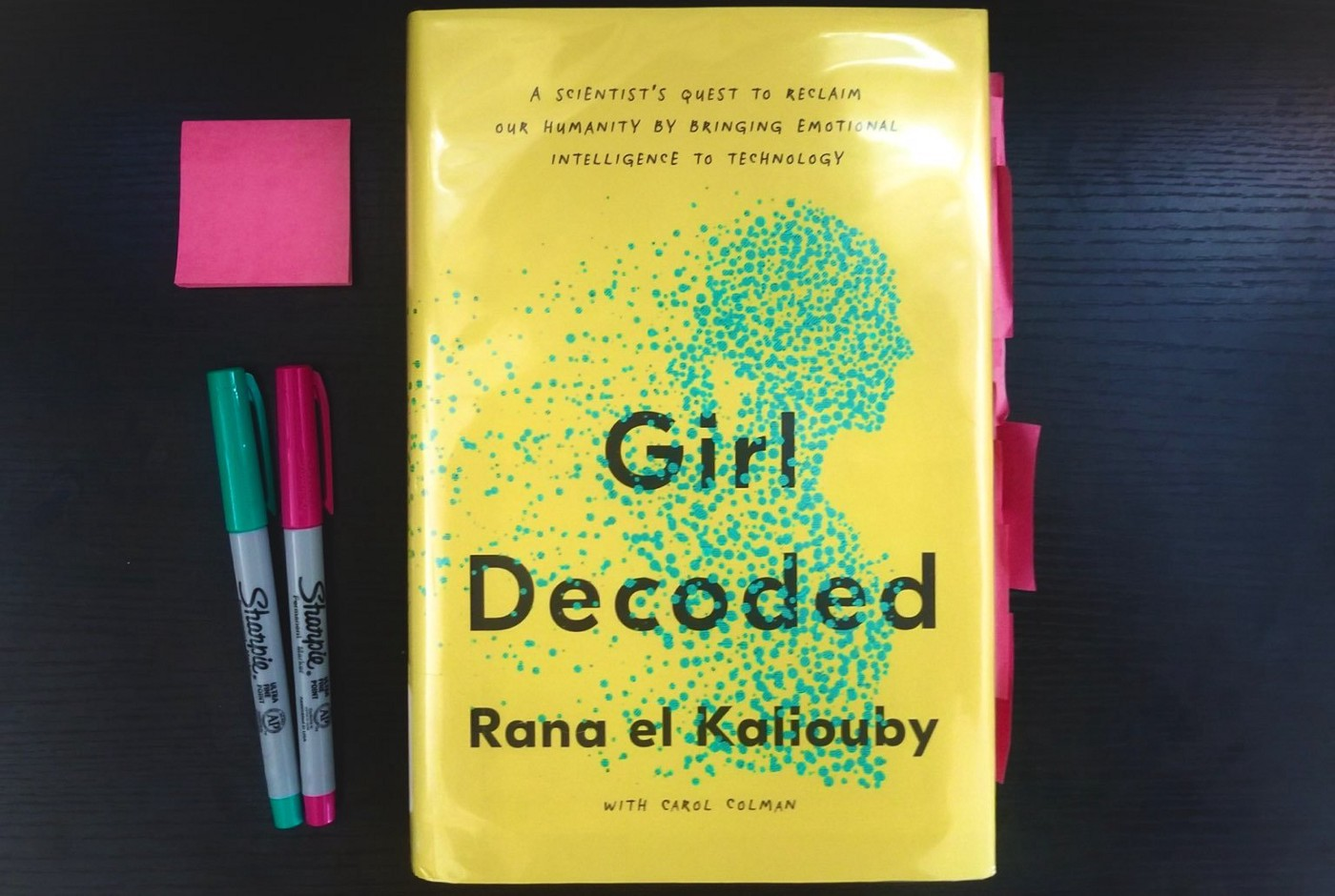"""""""Girl Decoded"""" book by Rana el Kaliouby on a desk with pens and sticky notes"""