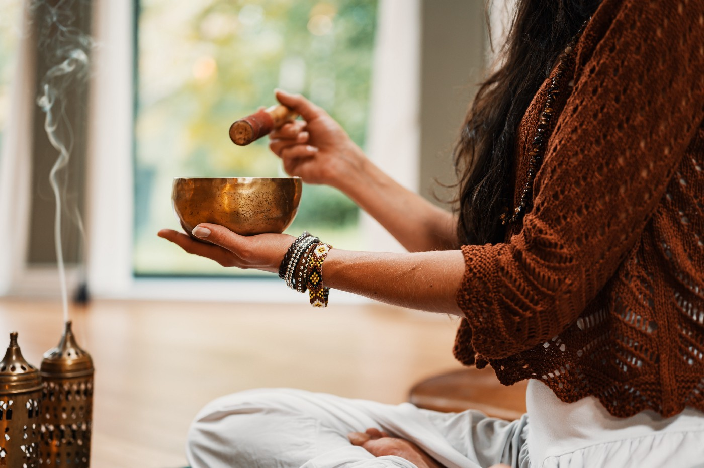 A person meditating with incense.