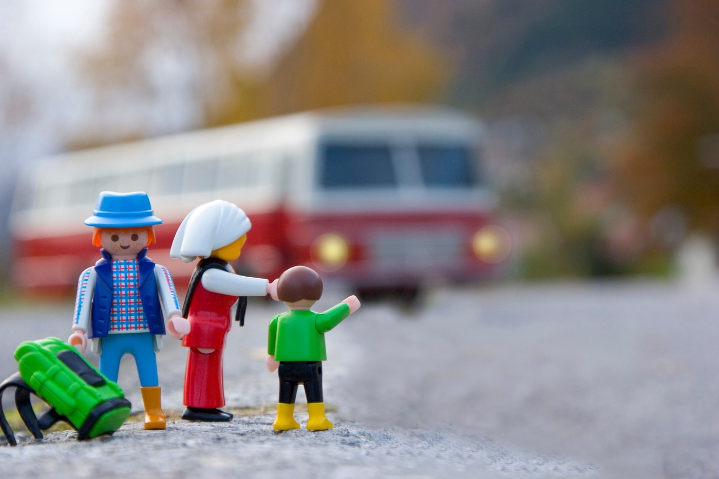 Photo of toy parents and child waiting for a bus