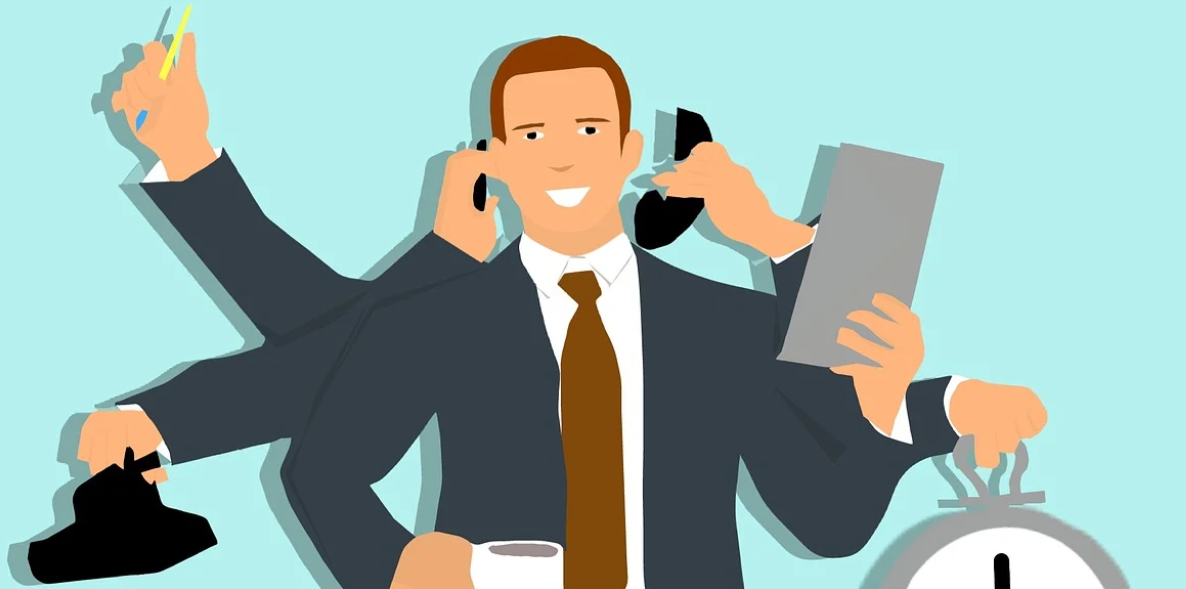 A cartoon drawing of a man wearing a suit using his many arms to multi-task whilst answering calls, reading things, carrying a clock and drinking a cup of coffee. He appears happy.