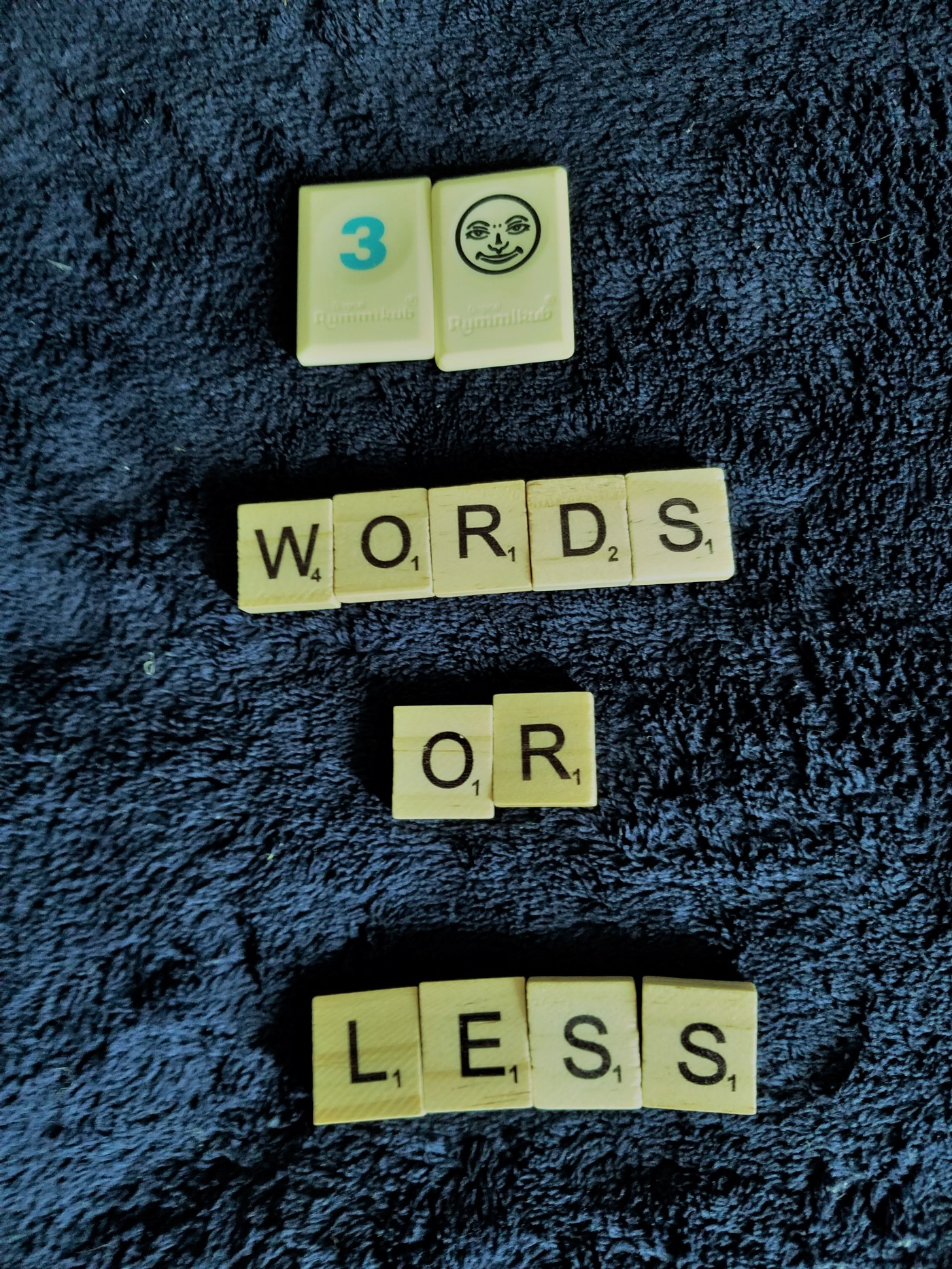"Letter tiles that read ""30 words or less"""