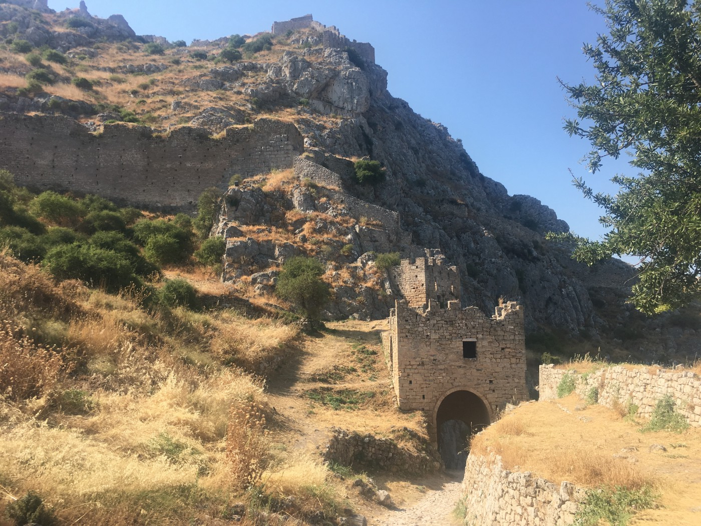 A view of battlements and ruined buildings atop Acrocorinth