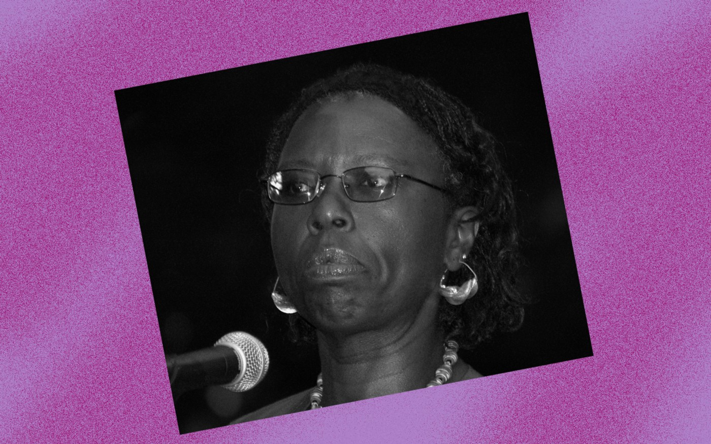 Black and white photo of Gloria Naylor against a violet background.