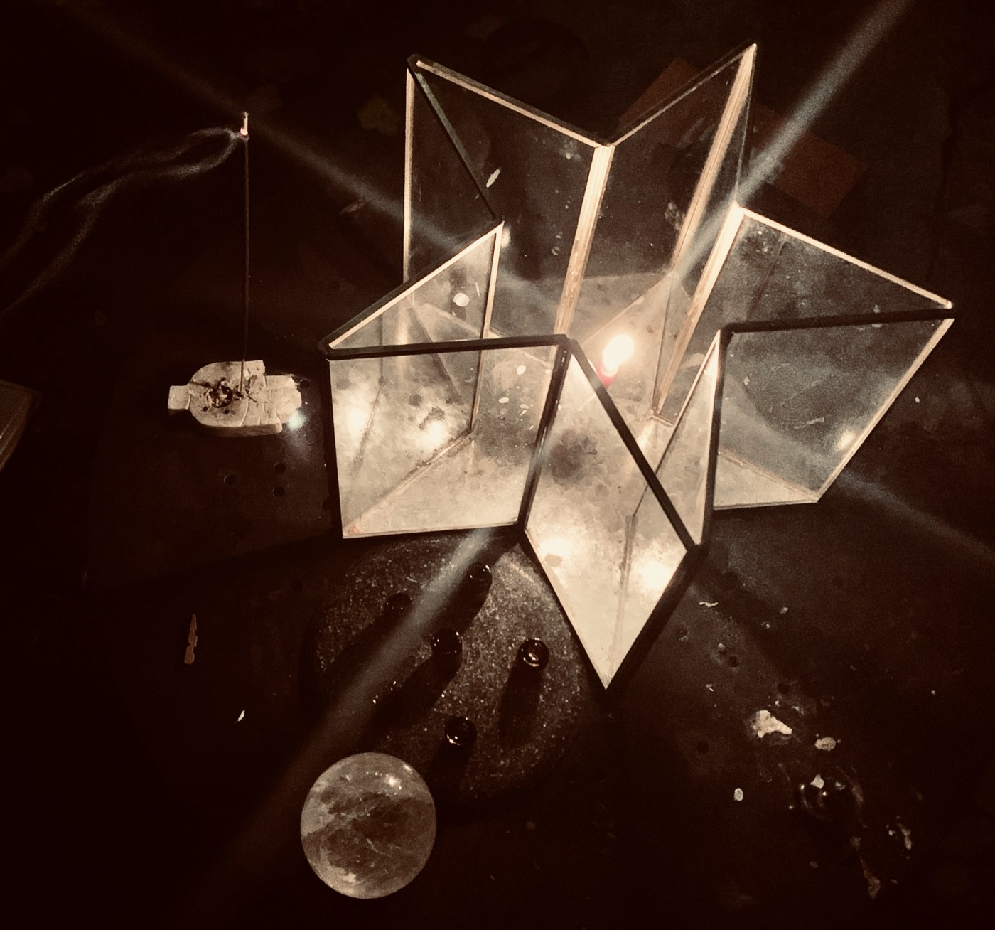 Photo of candle, crystal ball, and incense by Tara Plas.