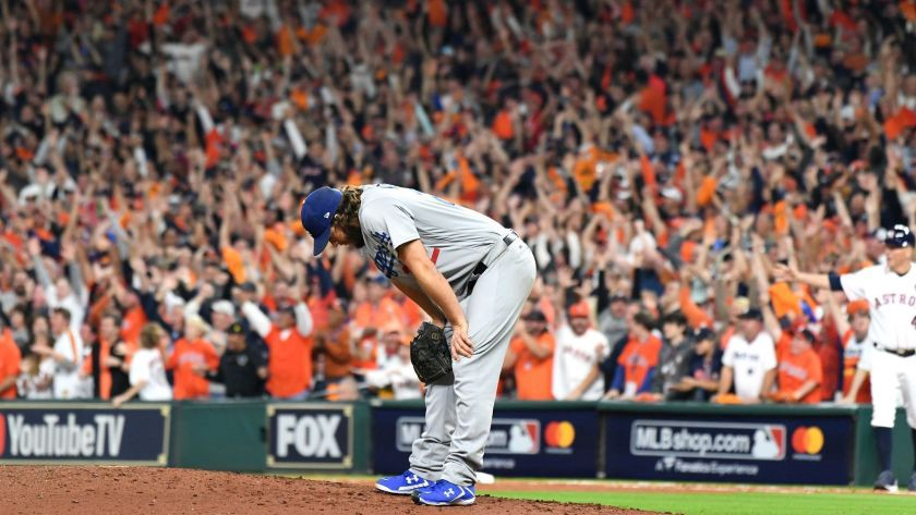 Clayton Kershaw reacts after giving up a three-run home run to the Astros' Yuli Gurriel during the 2017 World Series, Game 5