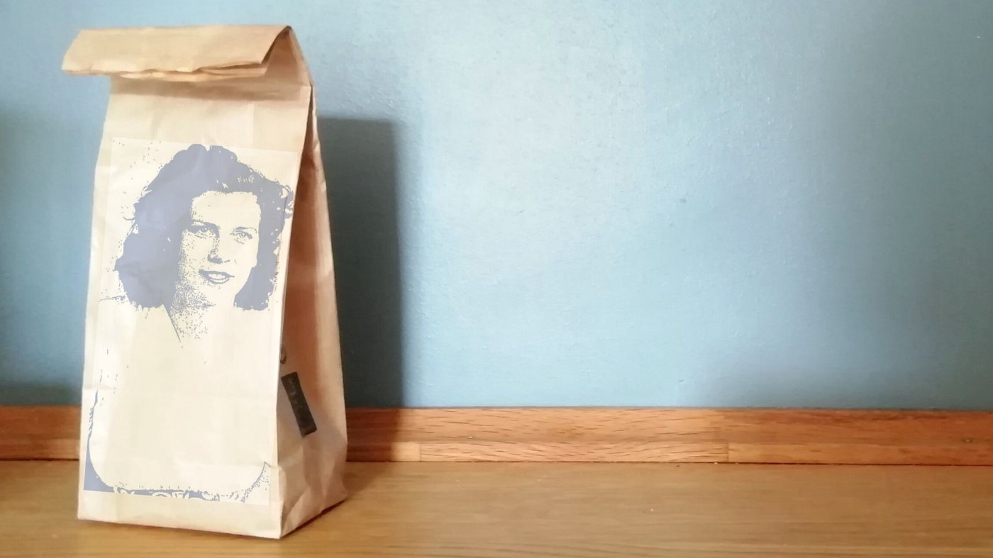 Margaret Knight's image superimposed on a paper grocery bag