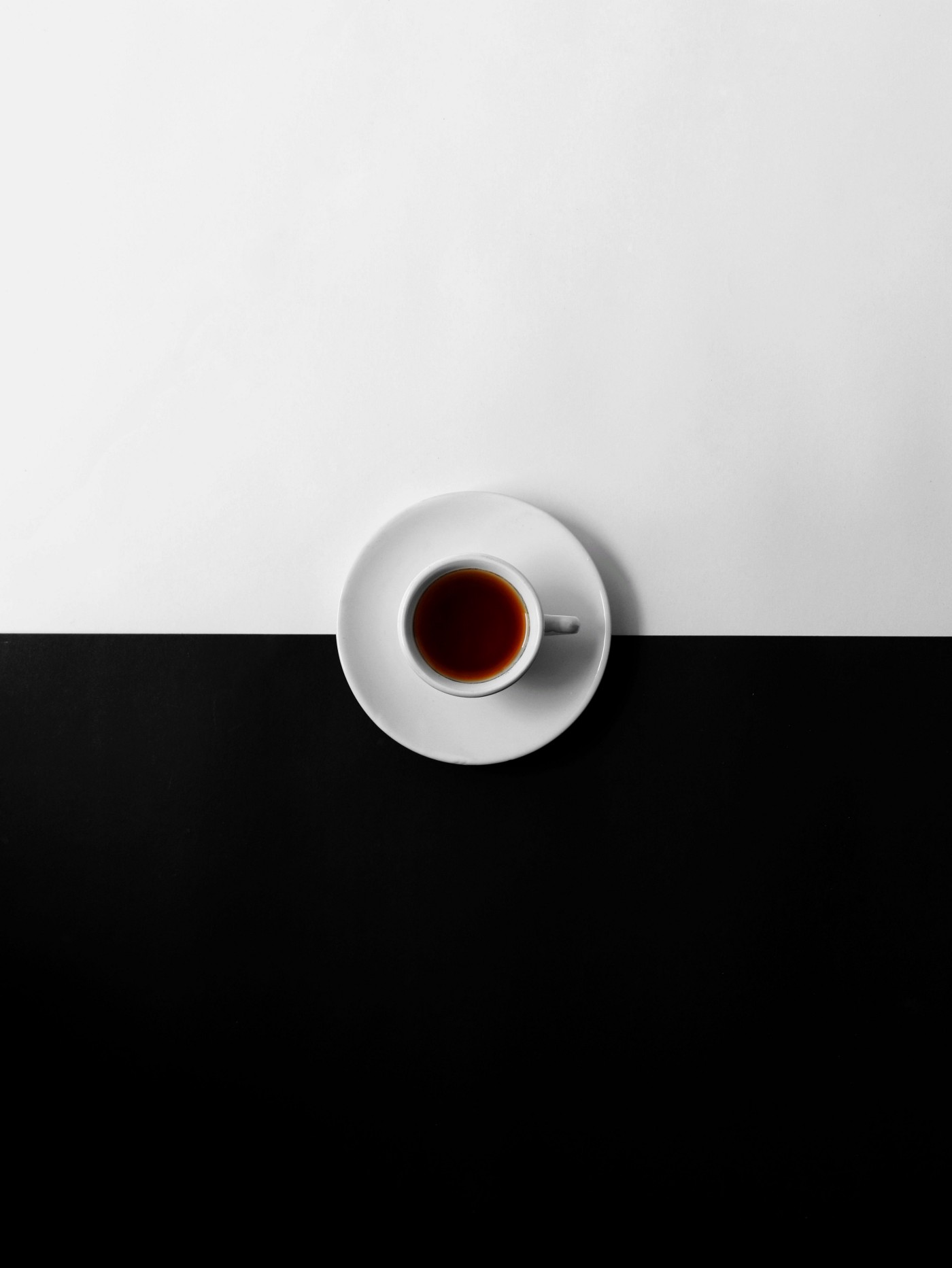 Image of cup of tea on black and white background. Photo by Mukul Wadhwa on Unsplash
