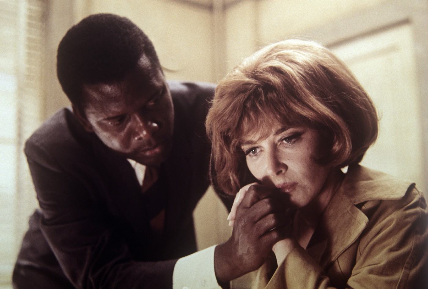 Sidney Poitier comforting a distraught Lee Grant in a scene of In the Heat of the Night