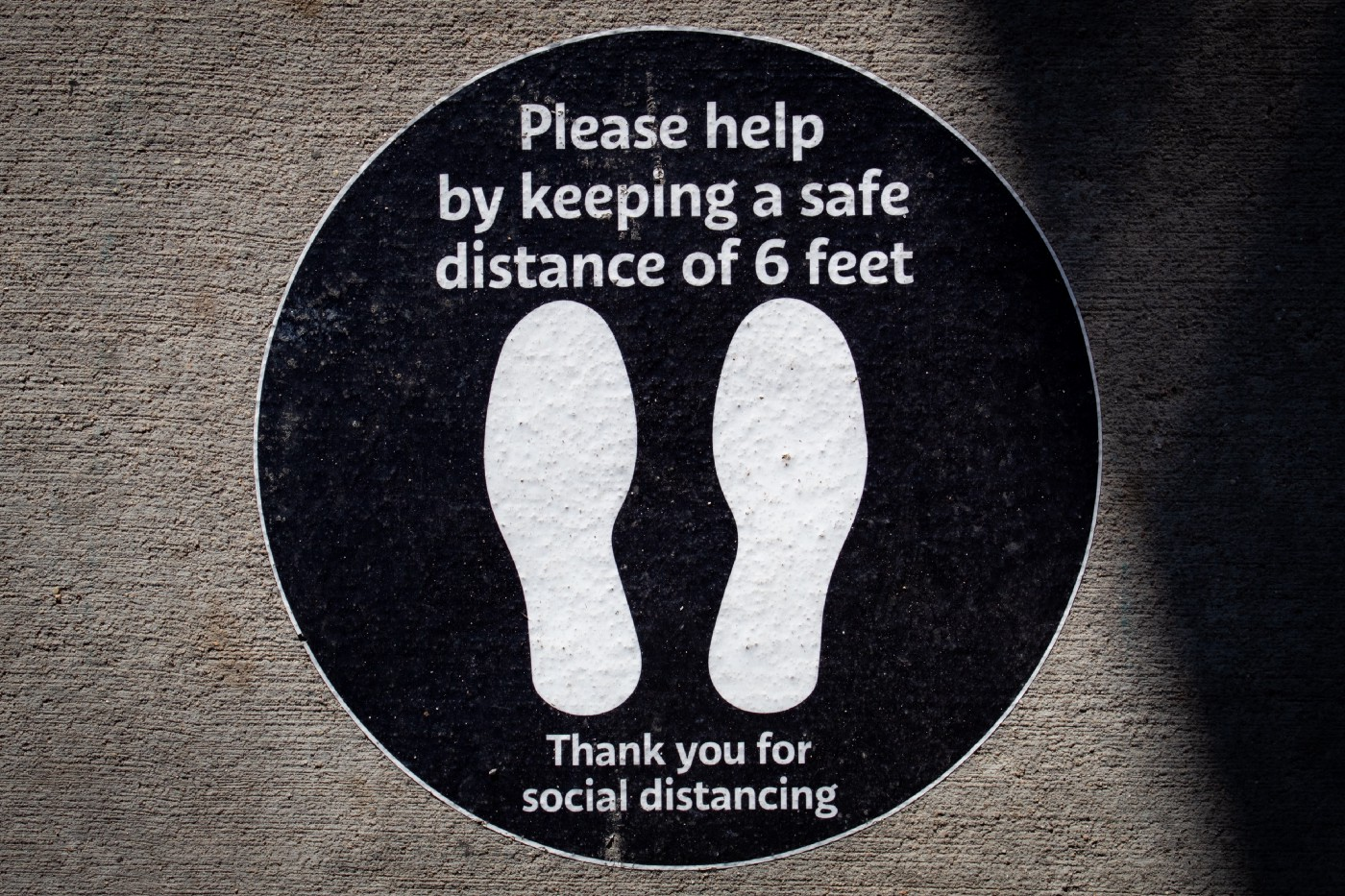 Photo of feet graphic with text please help by keeping a safe stance of 6 feet. Thank you for social distancing. Photo by Elizabeth McDaniel on Unsplash