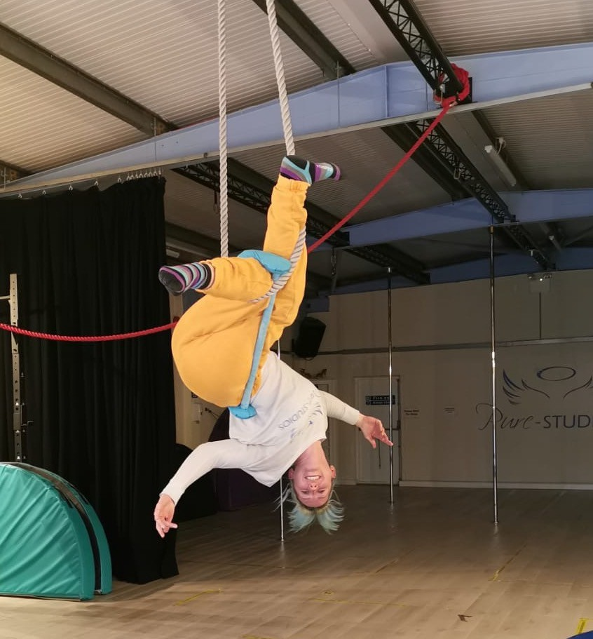 Vicky upside down in a twisted trapeze move