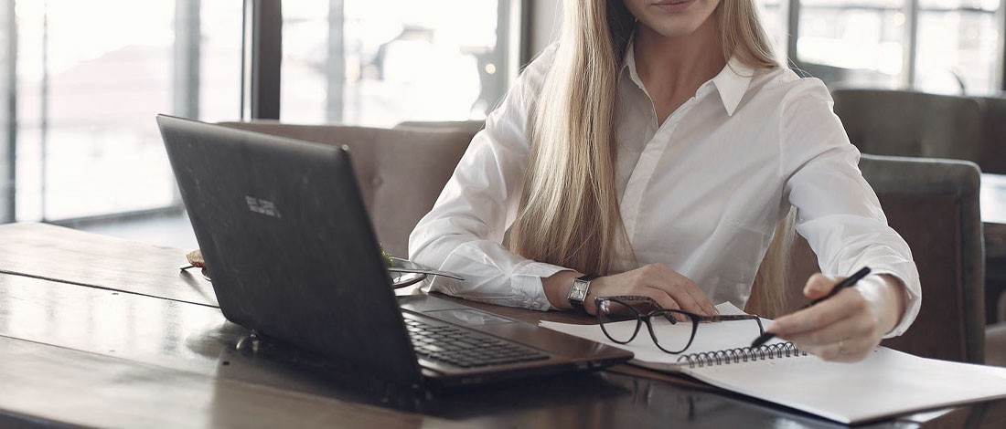 woman preparing for GRE in front of a laptop
