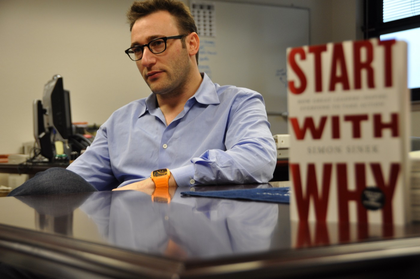Simon Sinek at Travis Air Force Base with his book Start with Why