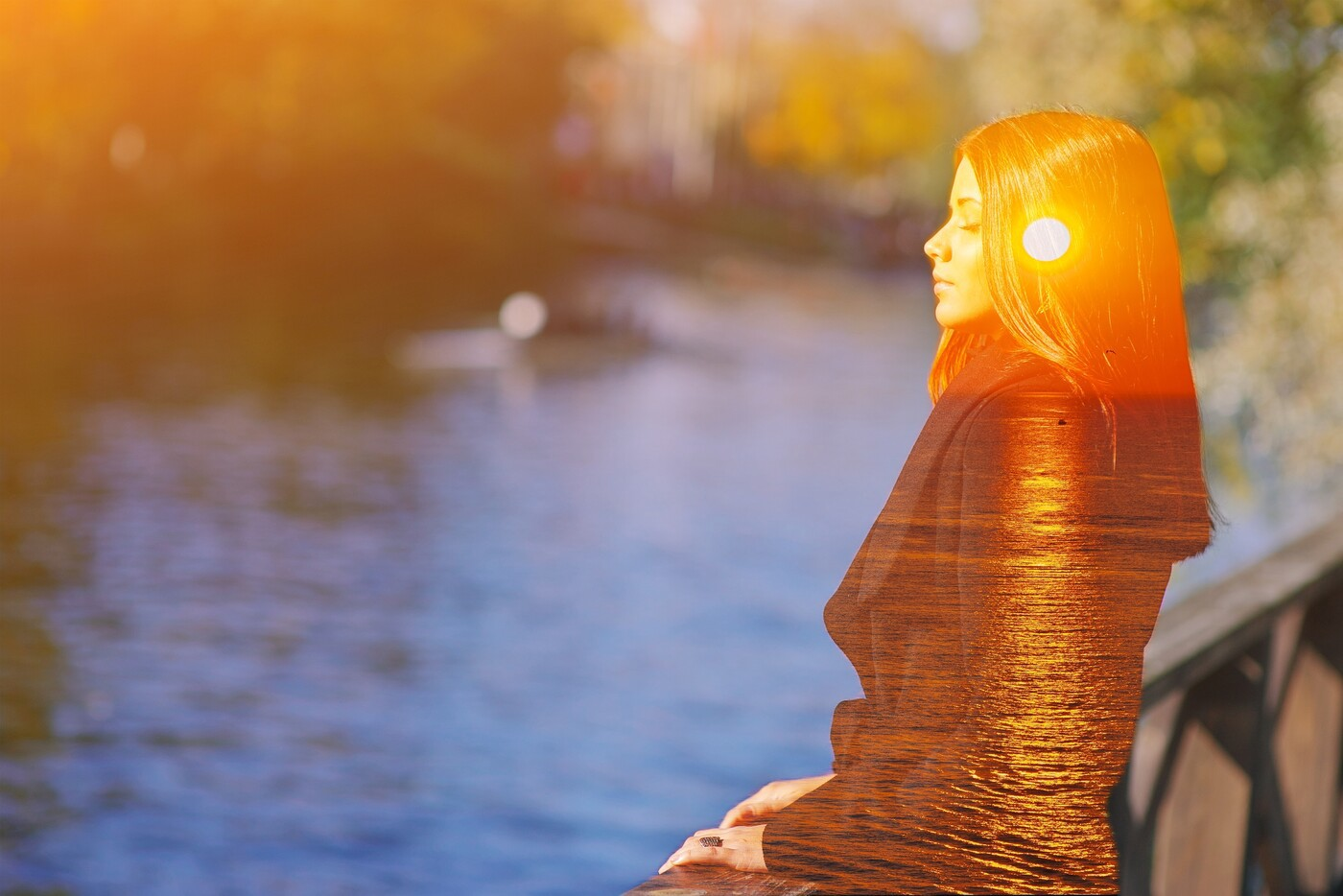 Double multiply exposure portrait of a dreamy woman mindfully meditating outdoors with eyes closed, combined photograph of nature, sunrise or sunset.