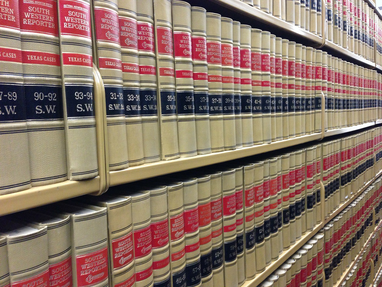 Volumes of law books in neat rows at legal library.