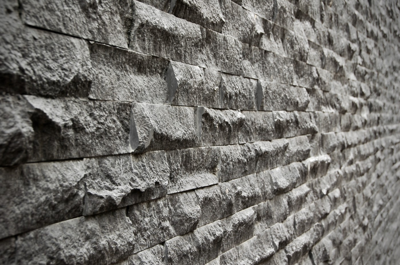 coarse rugged slanted lonely wall