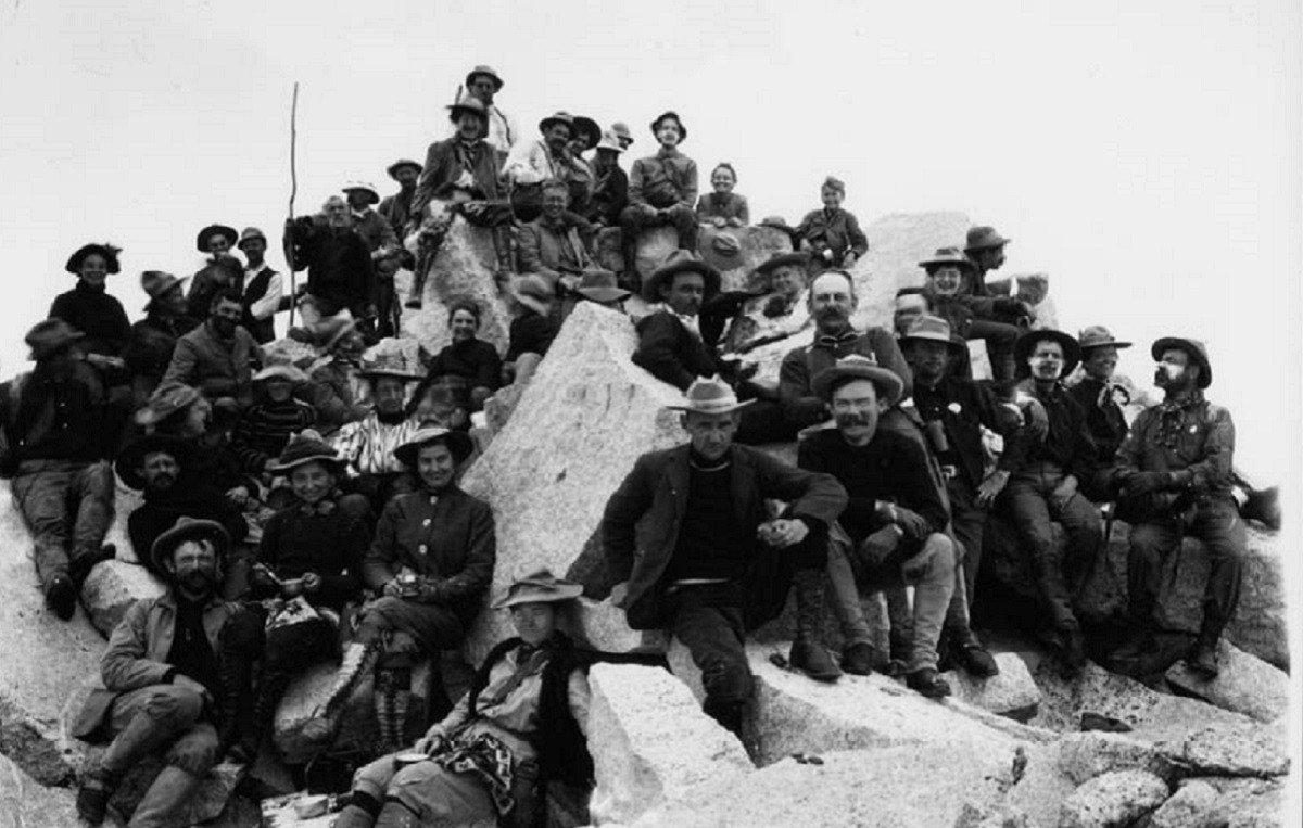 A group of turn-of-the-century Sierra Club members on the rocky top of Mt. Brewer.
