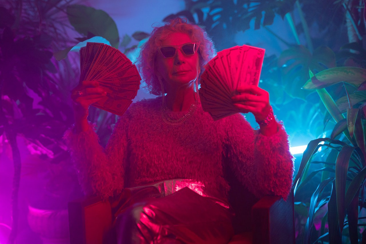 how much I made on medium, woman holding money, making money online, neon colours
