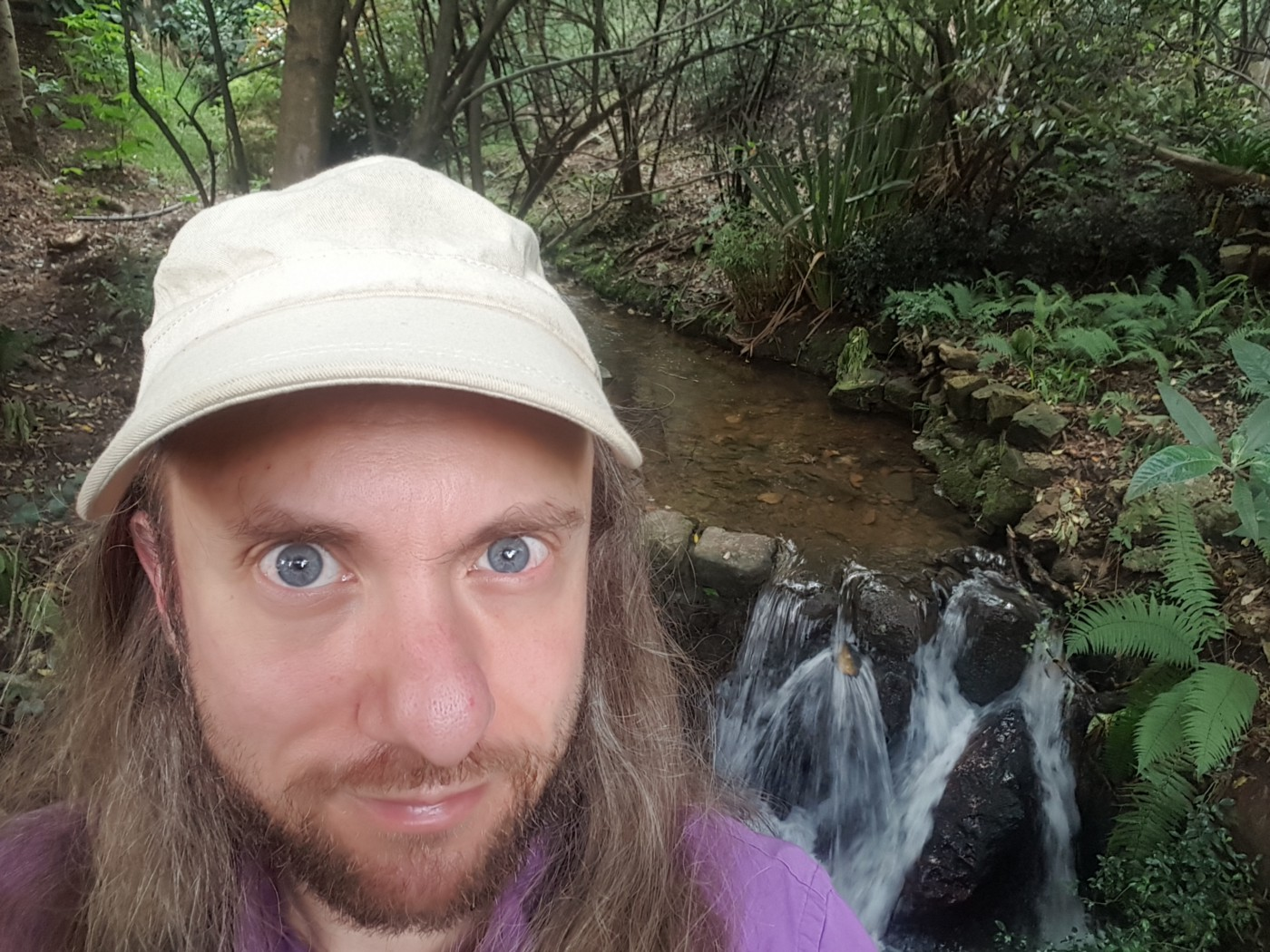 Tucker Lieberman standing by a small waterfall at Quebrada la Vieja in Bogotá, Colombia. 5 December 2020