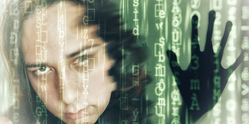 A slightly blurred face of an insanely beautiful light-skinned autistic transgender woman, superimposed with vertical green lines of code on a dark background. Beside her, to the right, is thesilhouette of a hand,pressing against the code as if it were a barrier it sought to escape.