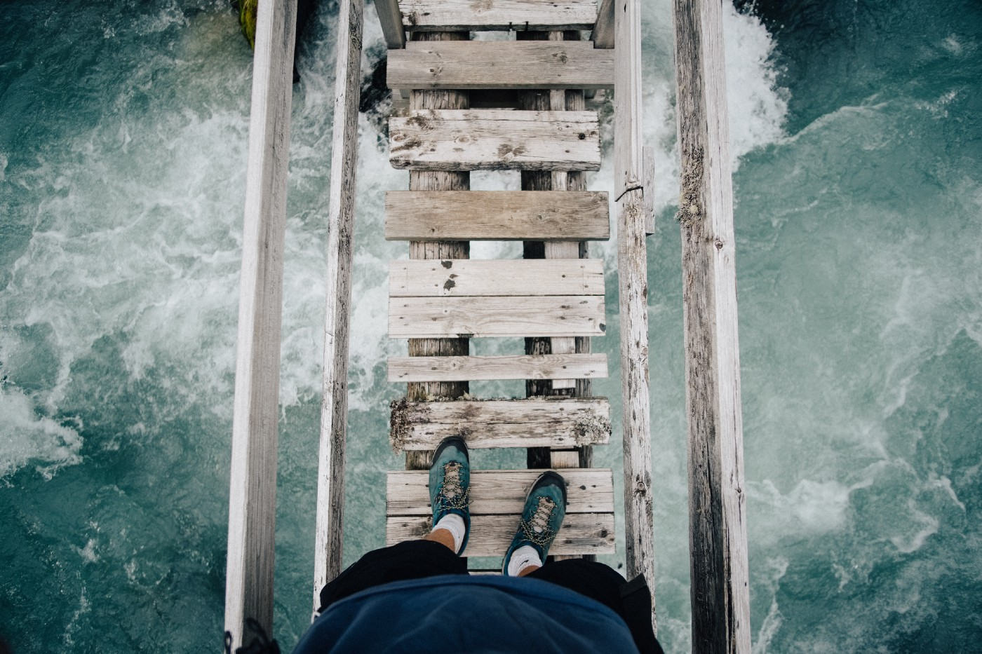 Feel the fear and do it—step by step over a rickety bridge over water
