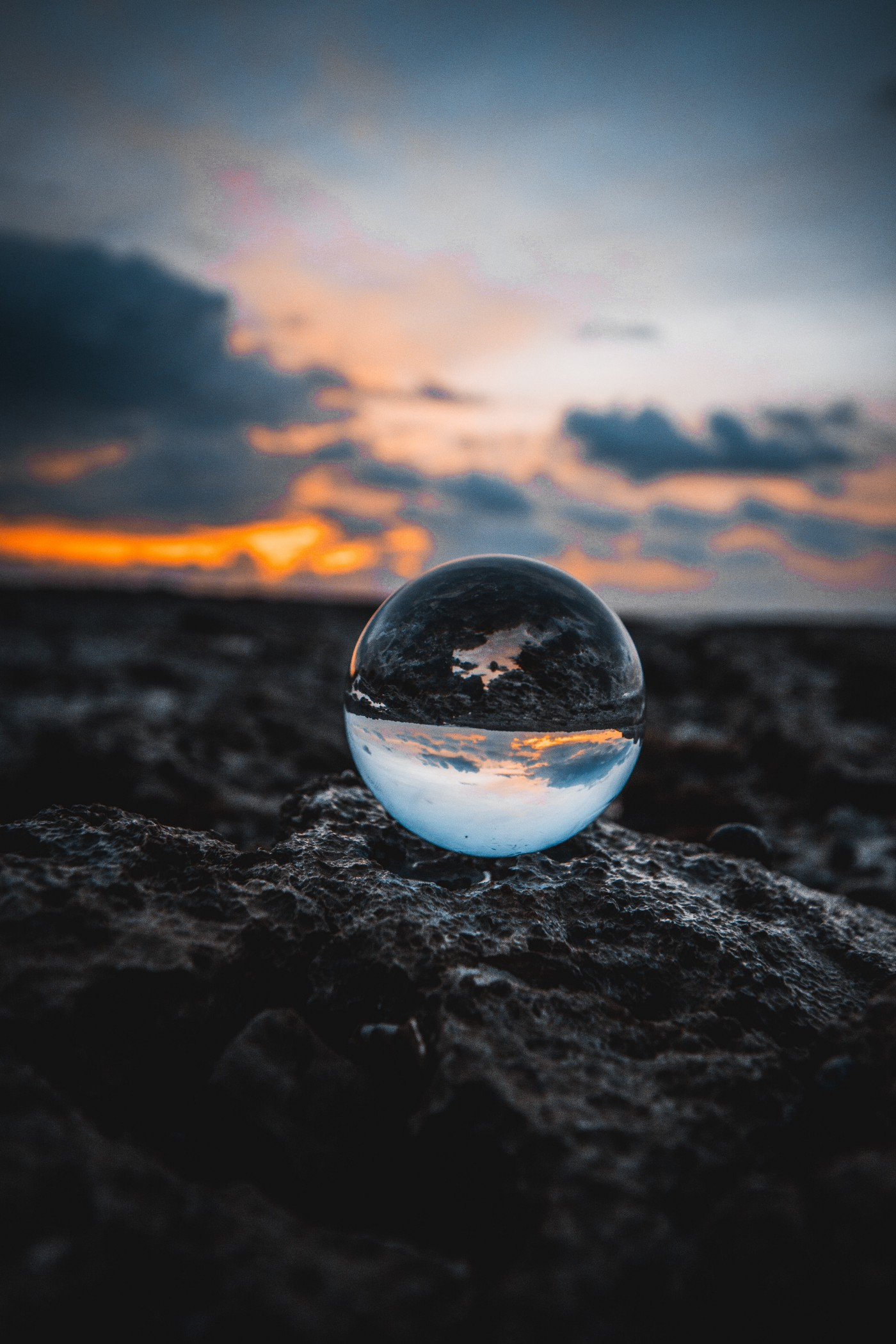 see through globe on rocks Photo by Louis Maniquet