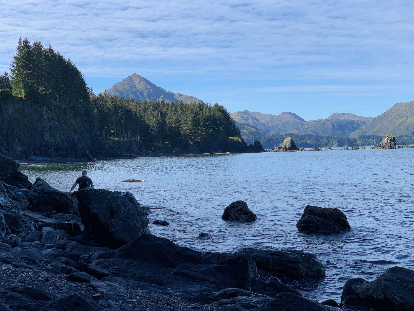 A man walking on the beach in Kodiak, Alaska.