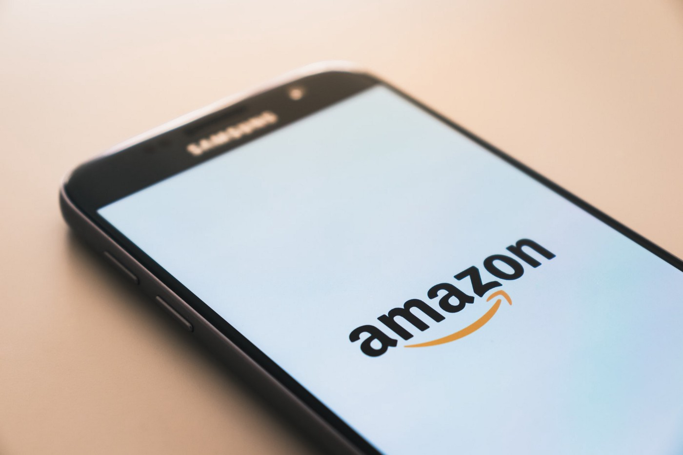 photo of phone with Amazon logo showing the App open