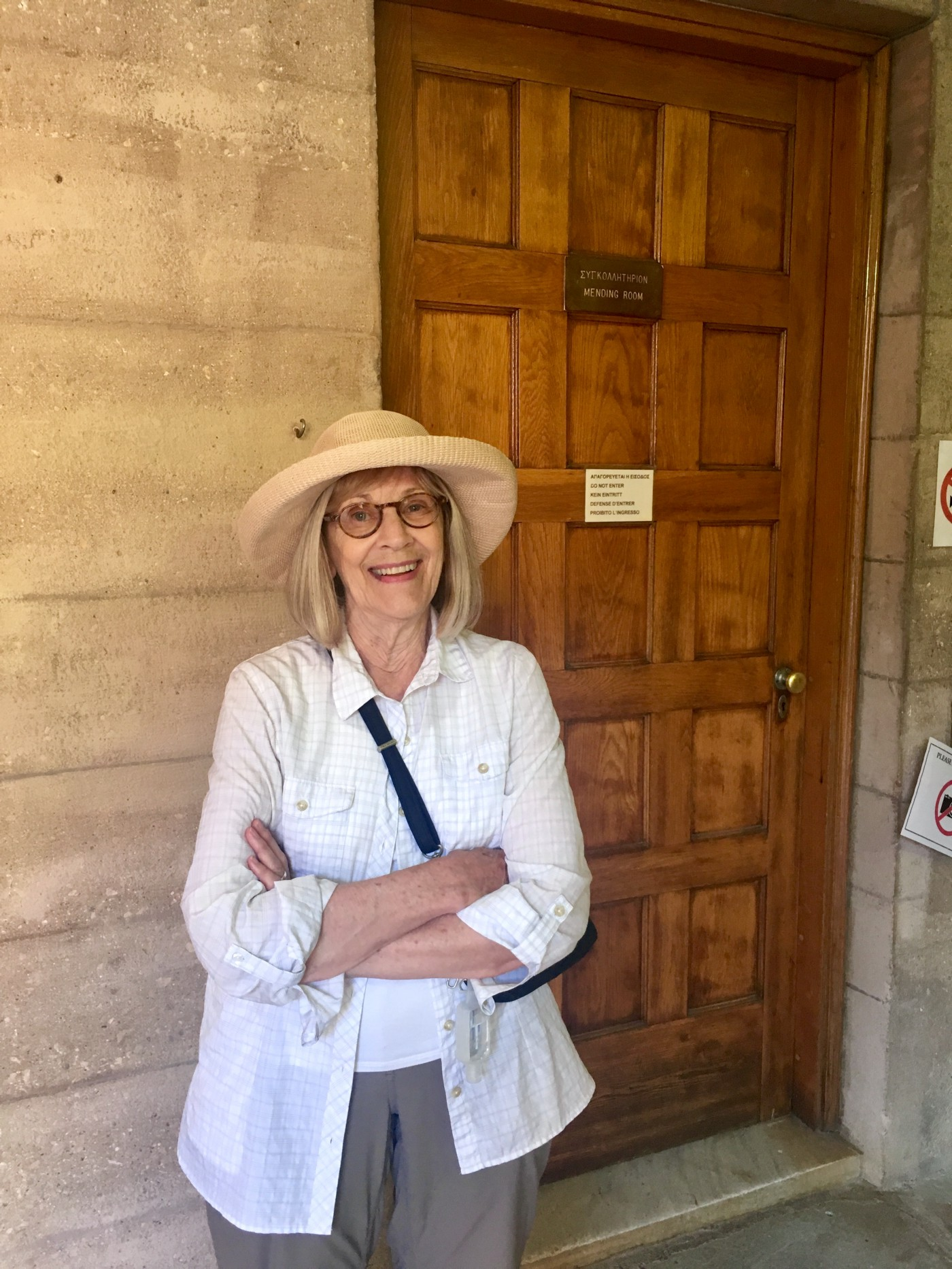My mother at the archaeological museum in Corinth, outside the mending room where she used to work