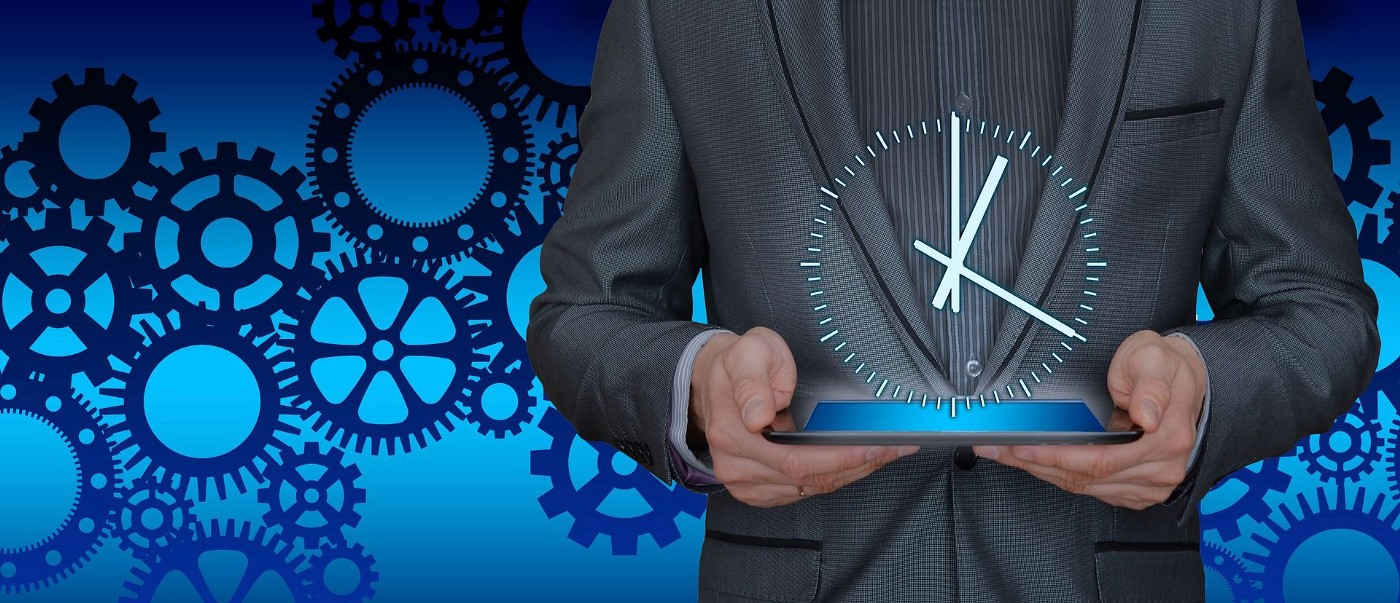 A man holding an iPad with an image of a clock superimposed in front of him to insinuate the time value of productivity