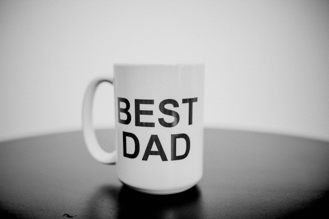 """A coffee cup with """"Best Dad"""" written across it. A pretty arbitary award and relly only meaningful to the person who owns it."""