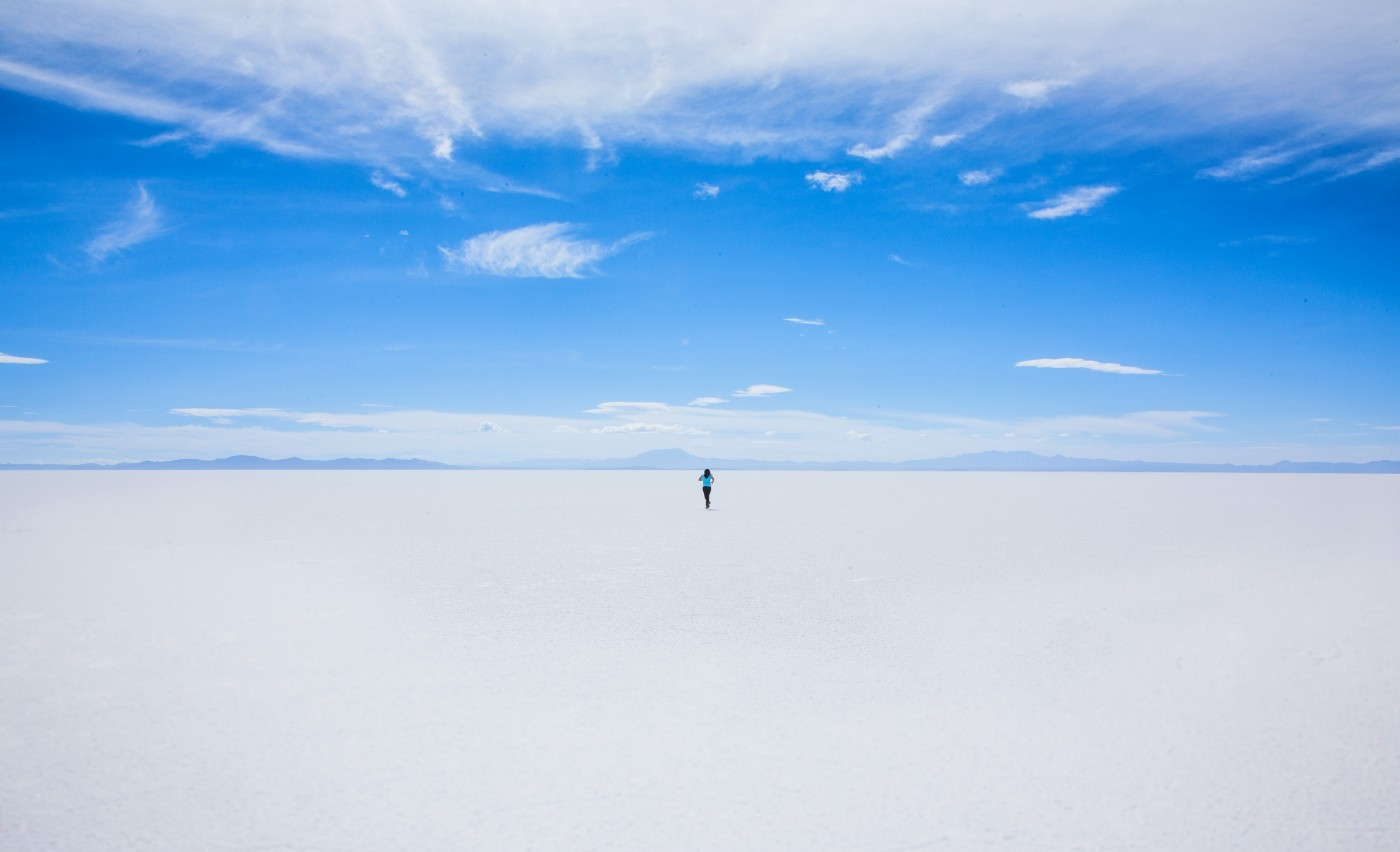 Person walking on an empty landscape