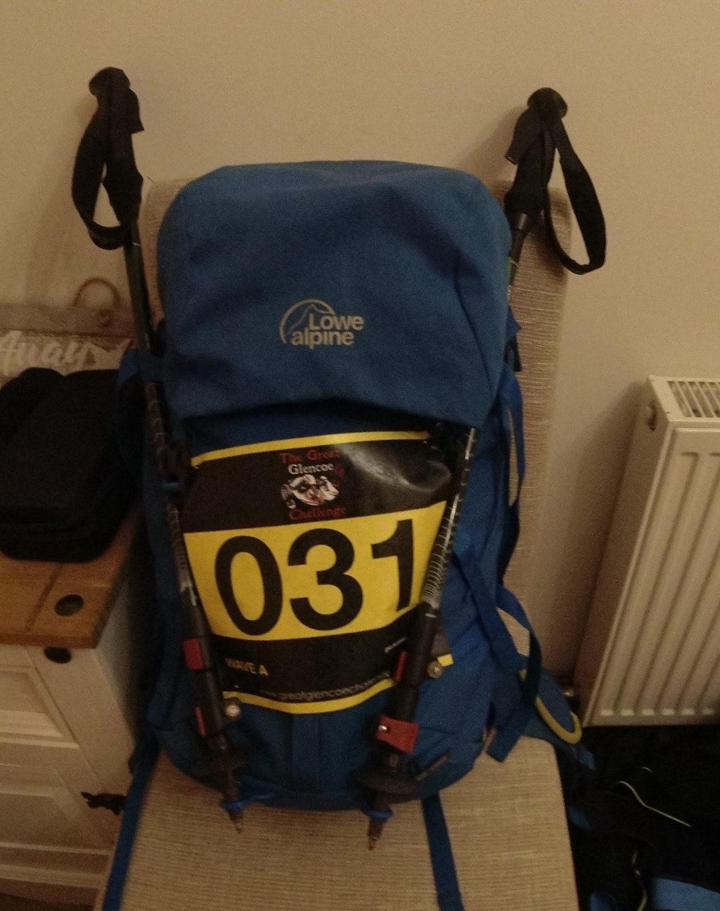 Backpack with walking poles and a Running Number.